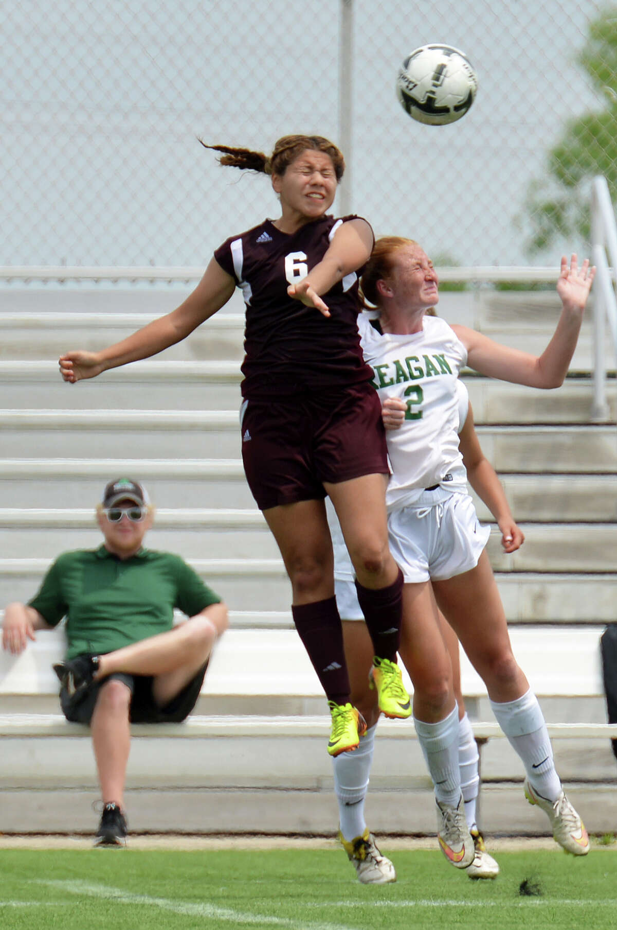 Los Fresnos Falcon Susie Rodriguez (6) leaps to head the ball Saturday against San Antonio Reagan Rattler Devyn Hagan (2) during the U.I.L. Region IV-6A Regional Soccer Tournament championship game at Brownsville Sports Park.