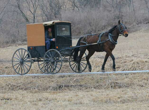 An Amish horse and buggy is seen on a road on Wednesday, April 8, 2015 in St. Johnsville, N.Y. A local farmer, Robert Madsen, was found guilty for sexually abusing 6 Amish boys in 2006. (Lori Van Buren / Times Union) Photo: Lori Van Buren
