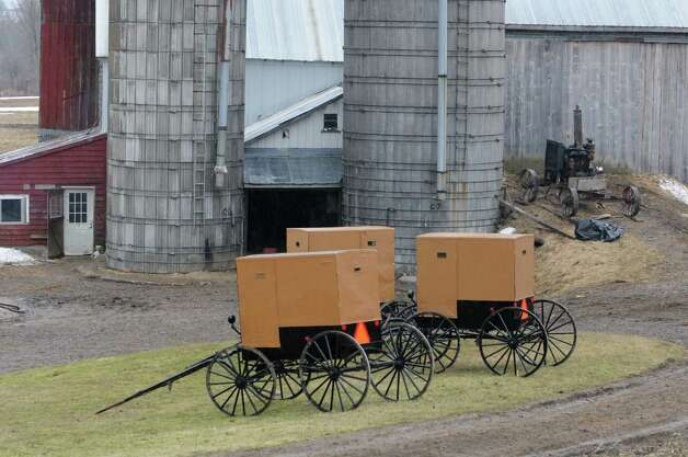 Amish buggies are seen on a farm on Wednesday, April 8, 2015 in St. Johnsville, N.Y. A local farmer, Robert Madsen, was found guilty for sexually abusing 6 Amish boys in 2006. (Lori Van Buren / Times Union) Photo: Lori Van Buren