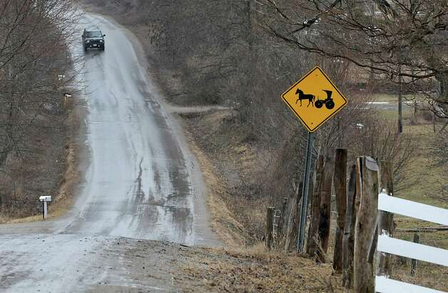 An Amish horse and buggy sign is seen on the side of the road on Wednesday, April 8, 2015 in St. Johnsville, N.Y. A local farmer, Robert Madsen, was found guilty for sexually abusing 6 Amish boys in 2006. (Lori Van Buren / Times Union) Photo: Lori Van Buren