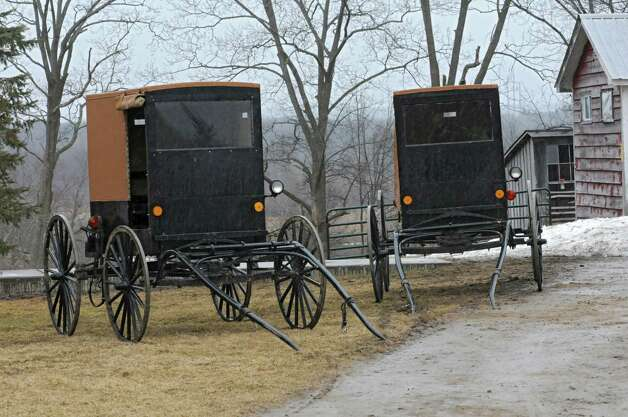 Amish buggies are seen at a farm on Wednesday, April 8, 2015 in St. Johnsville, N.Y. A local farmer, Robert Madsen, was found guilty for sexually abusing 6 Amish boys in 2006. (Lori Van Buren / Times Union) Photo: Lori Van Buren