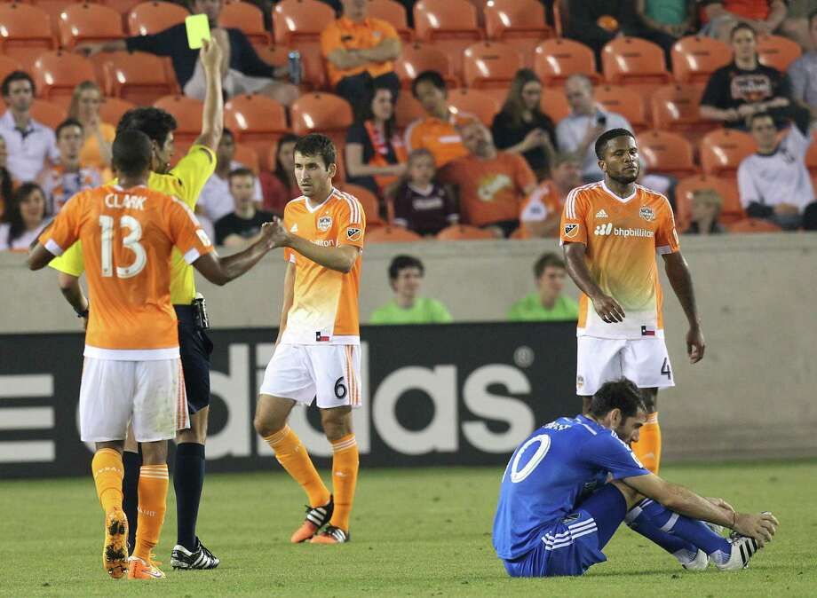 Houston Dynamo midfielder Nathan Sturgis (6) gets a yellow card after he made a dangerous kick against Montreal Impact midfielder Ignacio Piatti (10) in the second half at BBVA Stadium on Saturday, April 11, 2015 in Houston, TX.  Dynamo won 3 to 0. Photo: Thomas B. Shea, For The Chronicle / © 2015 Thomas B. Shea
