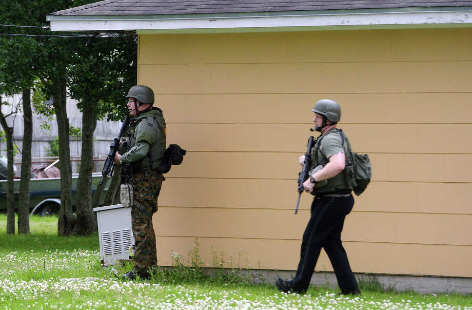 Officers with the Jefferson County Sheriff's Office secure an area around a possible hostage situation in Port Neches on Saturday. Police responded to a possible hostage situation on Saba Lane in Port Neches on Saturday afternoon. A suspect was taken into custody around 6:30 p.m. Photo taken Saturday 4/11/15 Jake Daniels/The Enterprise Photo: Jake Daniels / ©2015 The Beaumont Enterprise/Jake Daniels