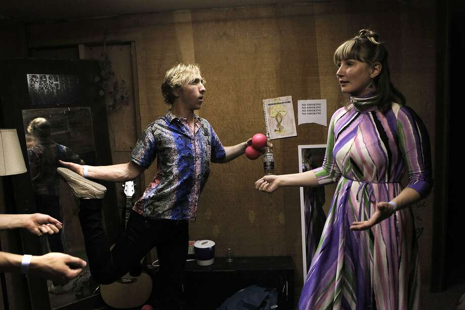 The three members of Be Calm Honcho, Michael Pettett, Alexander Weston, and Shannon Harney hang out in the dressing room before their show at Leo's in Oakland, Calif., Friday April 10, 2015. Photo: Sophia Germer, The Chronicle