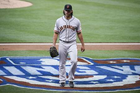 SAN DIEGO, CA - APRIL 11:  Madison Bumgarner #40 of the San Francisco Giants comes off the field after giving up three runs during the third inning of a baseball game against the San Diego Padres at Petco Park April 11,  2015 in San Diego, California.  (Photo by Denis Poroy/Getty Images)