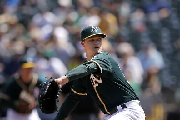 A's starting pitcher Sonny Gray throws as the Oakland Athletics take on the Seattle Mariners at O.co Coliseum in Oakland, Calif. on Sat. April 11, 2015.