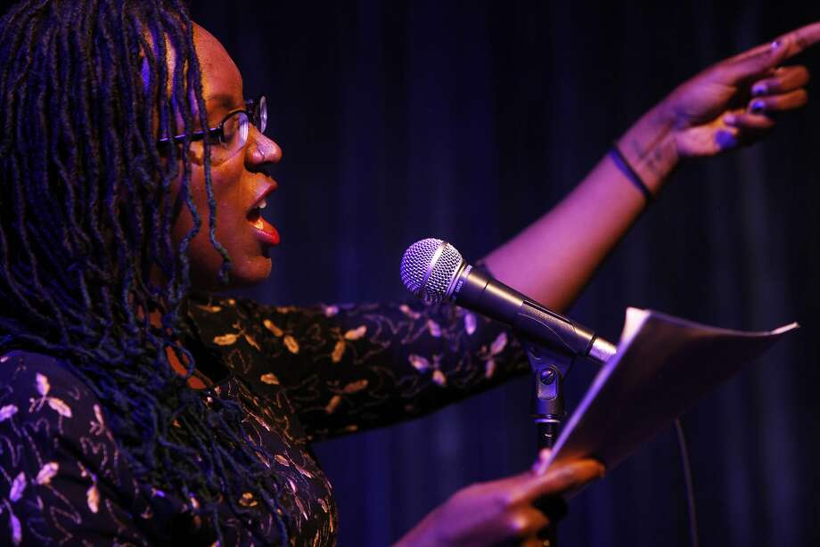 "Lisa Evans of San Diego recites the poem ""Berry Feast"" by Gary Snyder during the Birth of the Beats Salon event at Doc's Lab in the North Beach district of San Francisco, Calif. Saturday, April 11, 2015. Photo: Jessica Christian, The Chronicle"
