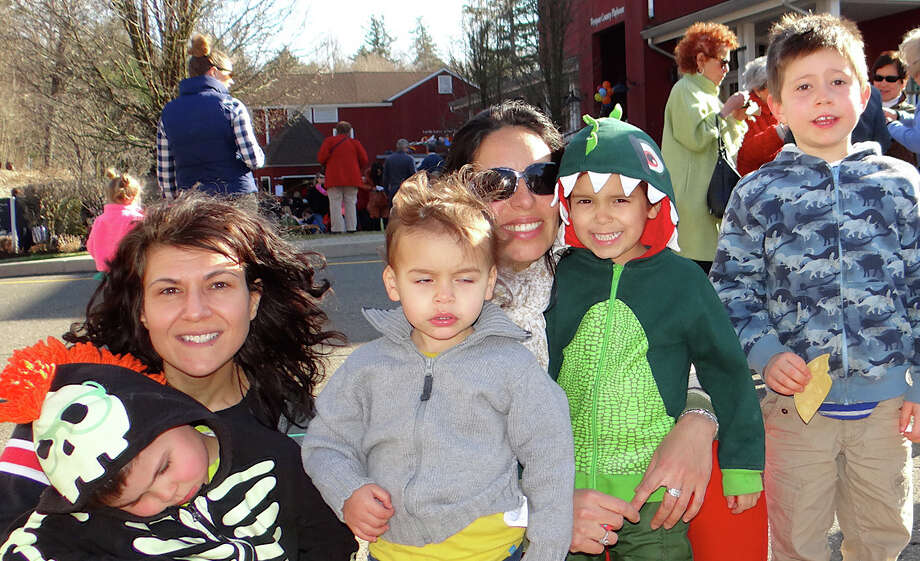Among those at the block party hosted by the Westport Country Playhouse were Athan Schmutte, 4, his mother Elenee Argentinis, both of Westport; Youri Tomasovic, 2, his mother Alma and elder son Noah, 5, of Westport, and Damian Shmutte. Photo: Mike Lauterborn / Westport News