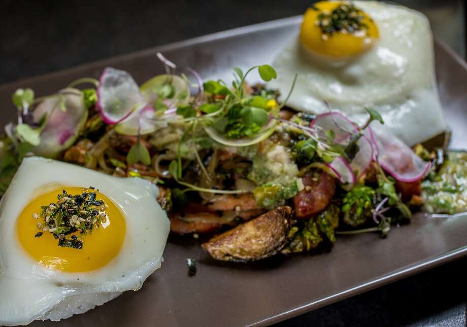 Portuguese sausage with Brussels sprout hash at 'Aina in S.F. Photo: John Storey, Special To The Chronicle