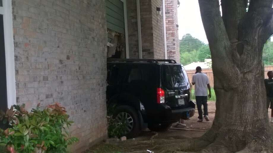 A 16-year-old boy without a driver's license crashed his mother's sport utility vehicle through an apartment wall Saturday, injuring a woman sitting on her couch, authorities said. Photo: Skyla Ramirez