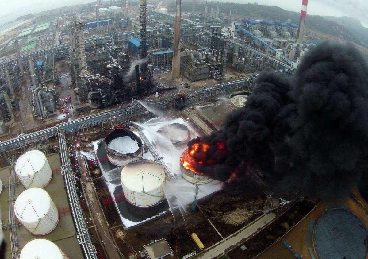Firefighters battle a fire at the explosion site of PX chemical plant on April 7, 2015 in Zhangzhou, China. Explosion hit Zhangzhou PX chemical plant at 18:58 on April 6 due to oil leaking with no casualty found.