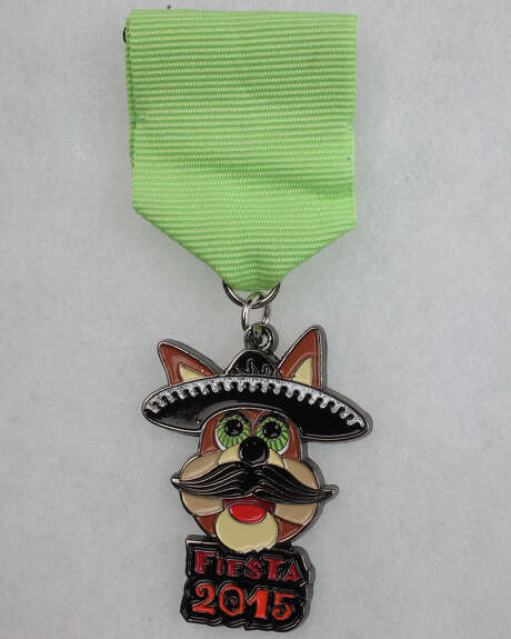 The Spurs Coyote is out front on the 2015 Silver & Black Give Back Fiesta Medal. Photo: By Juanito Garza,  San Antonio Express-News / San Antonio Express-News