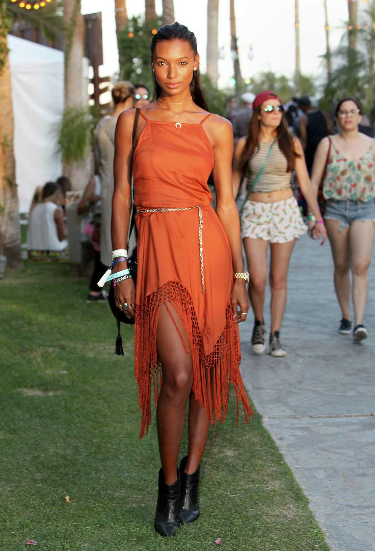 Jasmine Tookes in an Urban Outfitters dress and Rag and Bone boots attends the 2015 Coachella Valley Music and Arts Festival - Weekend 1 at The Empire Polo Club on April 11, 2015 in Indio, California.