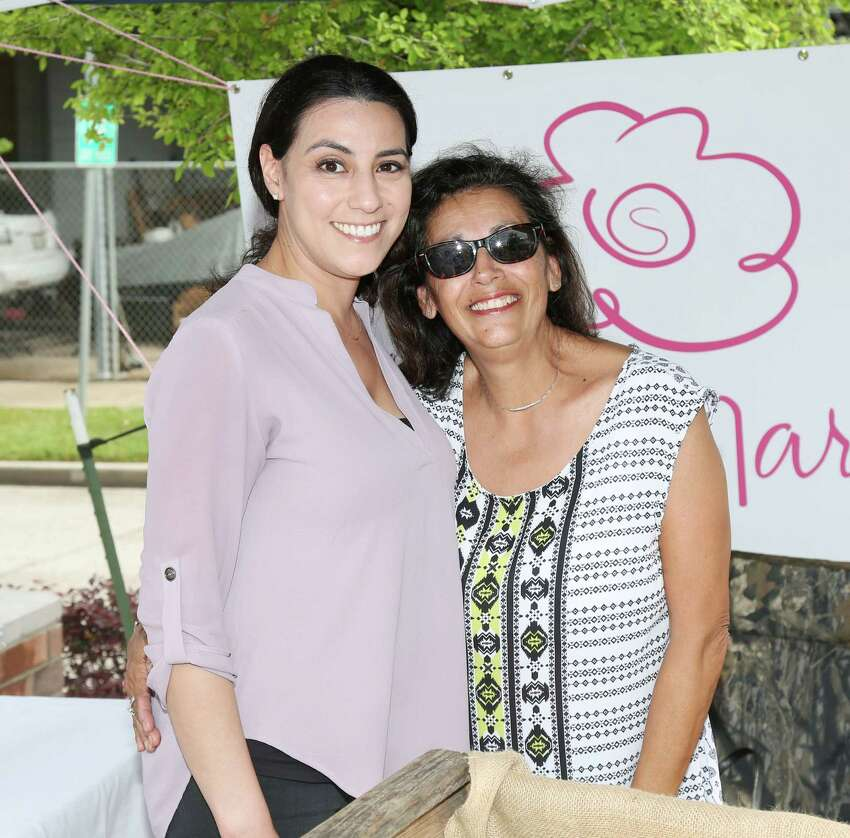 Guests pose for a photo at the inaugural East End Farmer's Market on the Navigation Blvd Esplanade Sunday, April 12, 2015, in Houston.