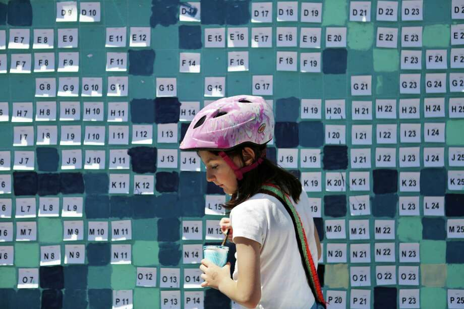 Beatrix (8), of San Francisco, works on a group pixel painting organized by San Francisco artist Paul Hayes during Sunday Streets on Third Street in the Dogpatch Neighborhood of San Francisco on Sunday, April 12, 2015. Photo: Terray Sylvester / The Chronicle / ONLINE_YES