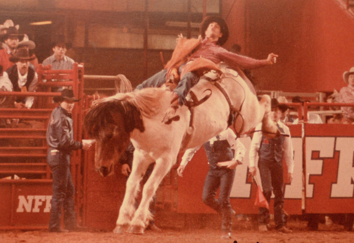 """Tim """"Monk"""" Dishman's in the 1983 National Finals Rodeo. Dishman was inducted to the Rodeo Hall of Fame on Saturday in Fort Worth. Photo taken Thursday, April 09, 2015 Guiseppe Barranco/The Enterprise"""