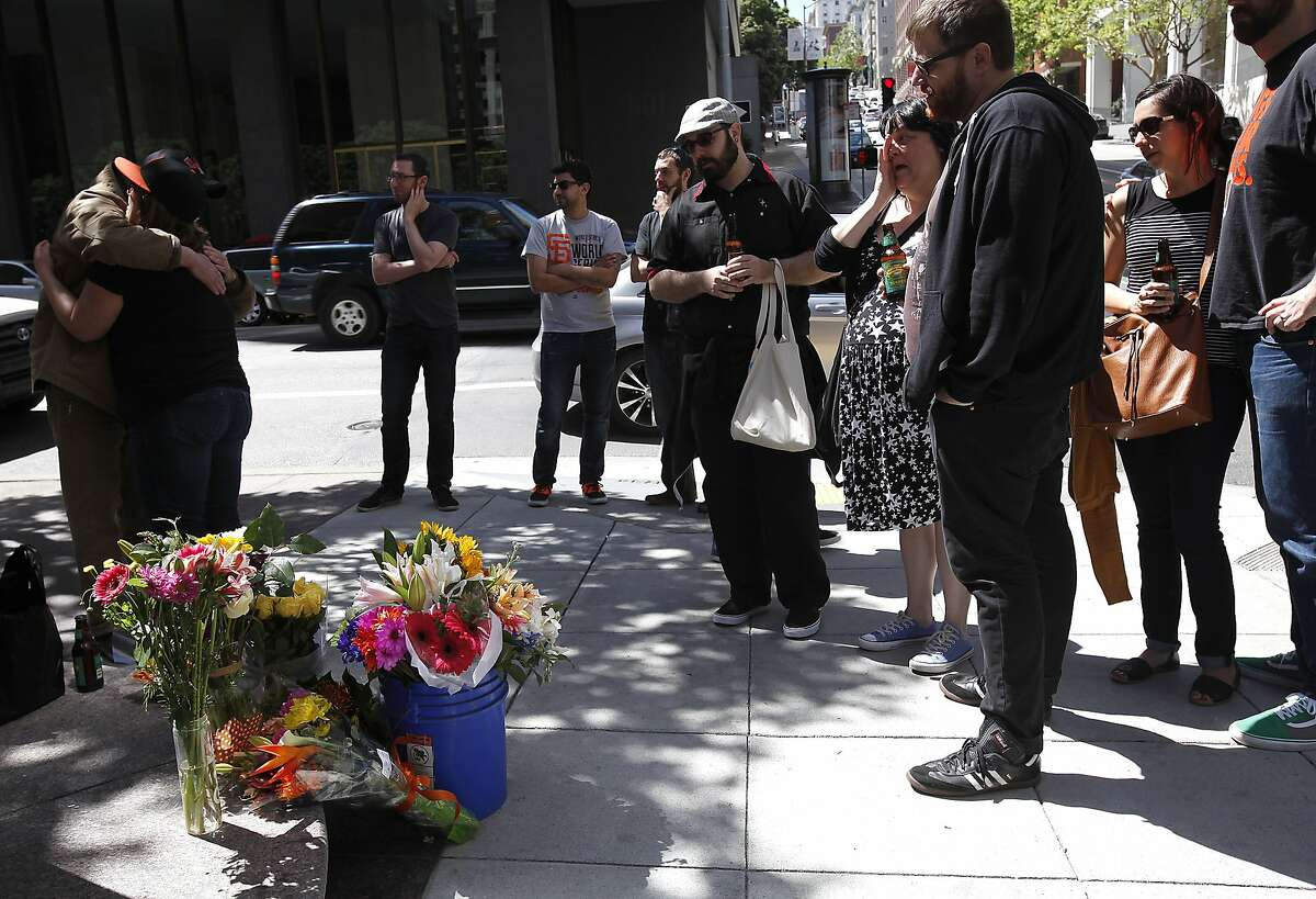 Friends gather at the corner of California St. and Kearny St. during a memorial for Bridget Klecker, who was hit and killed by fleeing armed robbers Friday night in San Francisco, Calif., on Sunday, April 12, 2015.