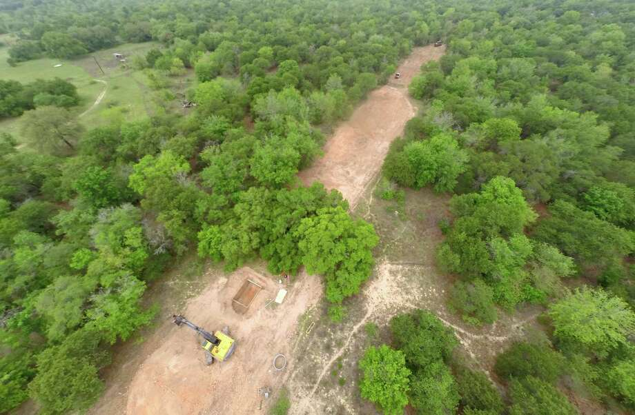 A swath of Edgar Castillo's land in South Bexar County covered by a wildlife habitat tax exemption has been stripped bare by crews preparing to install a large SAWS water line to move water northward. Photo: William Luther / San Antonio Express-News / © 2015 San Antonio Express-News