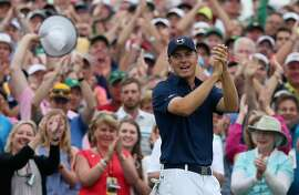 AUGUSTA, GA - APRIL 12:  Jordan Spieth of the United States celebrates on the 18th green after his four-stroke victory at the 2015 Masters Tournament at Augusta National Golf Club on April 12, 2015 in Augusta, Georgia.  (Photo by Andrew Redington/Getty Images)