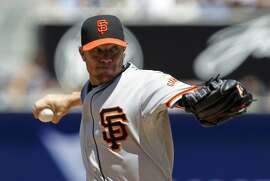 San Francisco Giants starting pitcher Jake Peavy throws against the San Diego Padres during the first inning of a baseball game in San Diego, Calif., Sunday, April 12, 2015. (AP Photo/Alex Gallardo)
