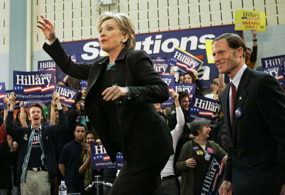 Democratic presidential hopeful, Sen. Hillary Rodham Clinton, D-N.Y., waves while taking the stage with Connecticut Atty. Gen. Richard Blumenthal during a rally in Hartford, Conn., Monday, Jan. 28, 2008. (AP Photo/Elise Amendola)