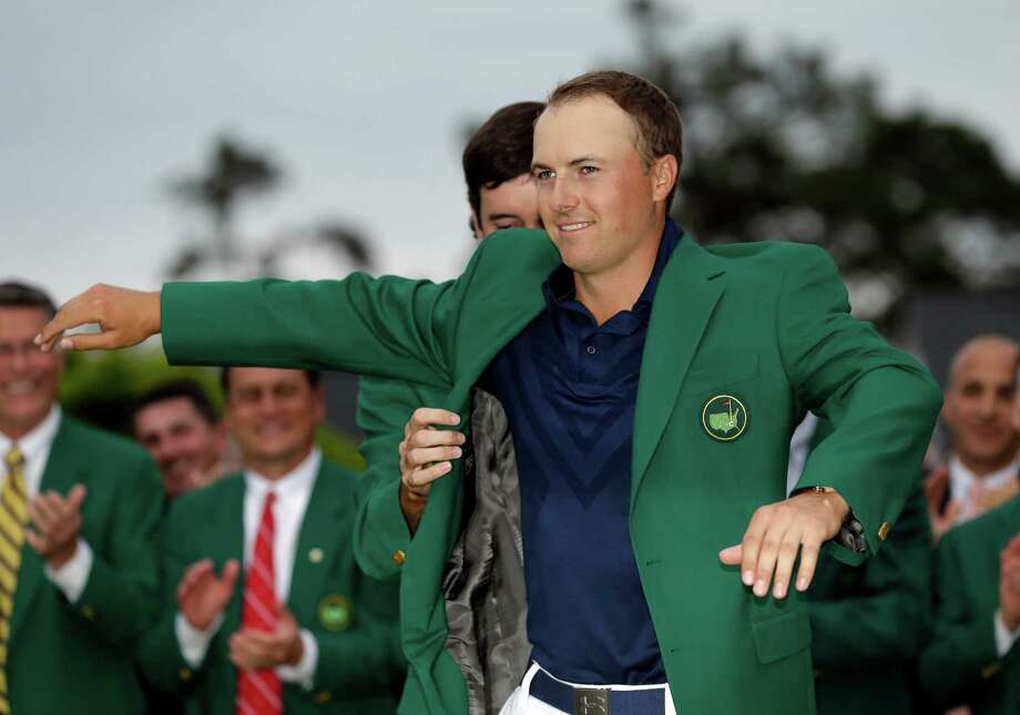 Bubba Watson helps Jordan Spieth put on his green jacket after winning the Masters golf tournament Sunday, April 12, 2015, in Augusta, Ga. (AP Photo/David J. Phillip) Photo: David J. Phillip, Associated Press / AP