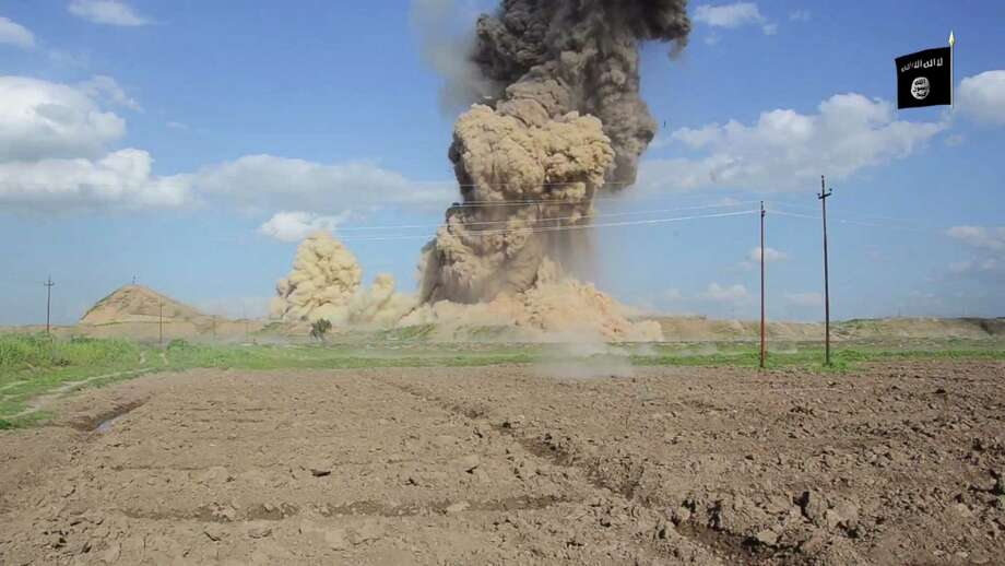 """In this image made from video posted on a militant social media account affiliated with the Islamic State group late Saturday, April 11, 2015, purports to show militants destroying the ancient Iraqi Assyrian city of Nimrud, a site dating back to the 13th century B.C., near the militant-held city of Mosul, Iraq. The destruction at Nimrud, follows other attacks on antiquity carried out by the group now holding a third of Iraq and neighboring Syria in its self-declared caliphate. The attacks have horrified archaeologists and U.N. Secretary-General Ban Ki-moon, who last month called the destruction at Nimrud """"a war crime.""""(militant video via AP) Photo: HONS / militant social media account"""