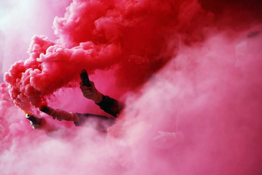 Fans of Stuttgart burn flares prior to the Bundesliga match between VfB Stuttgart and SV Werder Bremen at Mercedes-Benz Arena on April 12, 2015 in Stuttgart, Germany. Photo: Alex Grimm