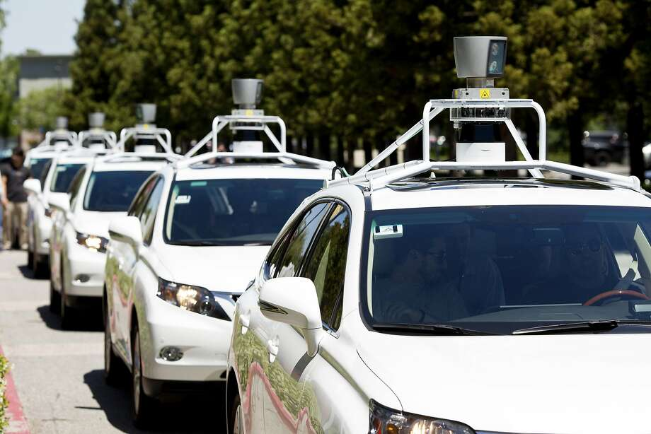 A fleet of Google self-driving cars lines up for demonstrations at the Computer History Museum in Mountain View. Photo: JASON HENRY / New York Times / NYTNS