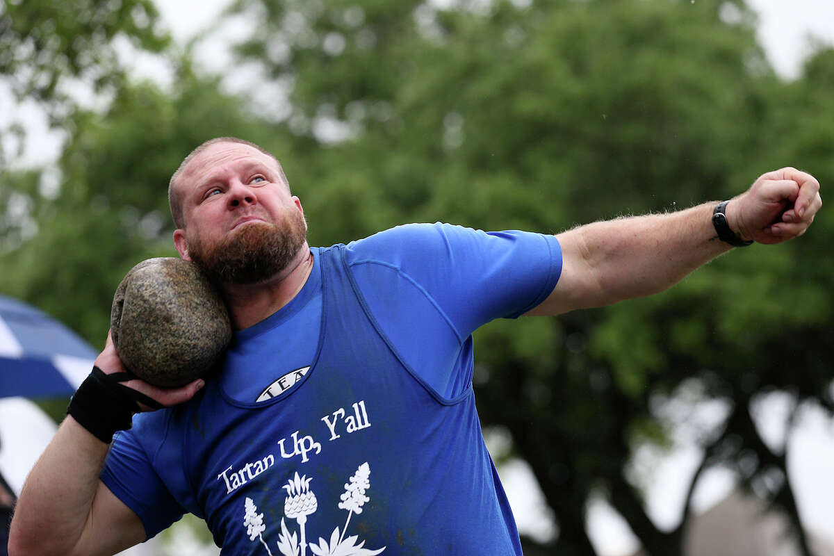 Michael Dickens, of Fredericksburg, competes in the stone put event during the Masters tournament at the San Antonio Highlands Games & Celtic Festival at the Helotes Fairgrounds, Sunday, April 12, 2015. The two day event featured food, exhibits and games.