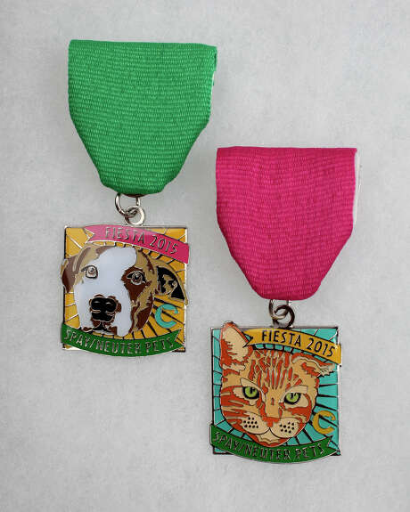 The Cannoli Fund's 2015 medals depict rescued animals. Photo: Juanito M. Garza / San Antonio Express-News / San Antonio Express-News