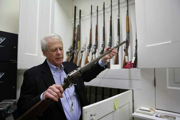 J.P. Bryan holds an 1855 Sporting Rifle, which is part of his rare collection of firearms that will be on display in The Bryan Museum.