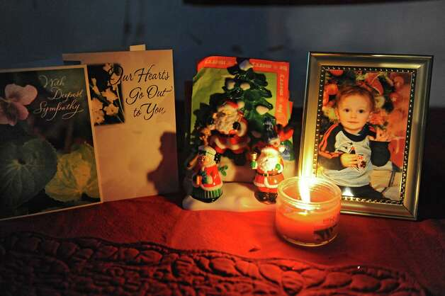 A small table top memorial for Eli James Hotaling is displayed in his grandmother's home on Tuesday, Dec. 23, 2014 in Canajoharie, N.Y. Eli died Dec. 9 after consuming liquid nicotine. (Lori Van Buren / Times Union) Photo: Lori Van Buren / 00029982A