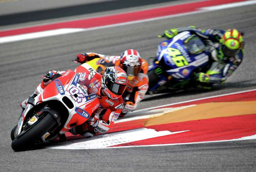 Ducati rider Andrea Dovizioso, 04, took the holeshot and led for the first few laps before being passed by eventual race winner Marc Marquez. Factory Honda rider Marc Marquez, 93, made it two for two as he cruised to a comfortable victory over Ducati-mounted Andrea Dovizioso, 04, and Yamaha rider Valentino Rossi, 46, on Sunday, April 12, 2015 at the Circuit of the Americas in Austin, Texas. Marquez has won back to back races in Austin, winning in his rookie year and also taking home the MotoGP title in 2014. Early rains parted and sunny skies prevailed allowing for a dry race flag to flag.
