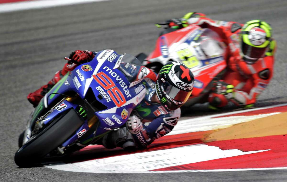 Suffering from bronchitis, Factory Yamaha rider and two-time MotoGP world champion Jorge Lorenzo, 99, soldiered on to a solid fourth place finish, picking up speed towards the end of the race. He finished well behind team mate Valentino Rossi who's clearly gunning for the number one rider position within the team as well as the overall championship at the age of 36. Factory Honda rider Marc Marquez, 93, made it two for two as he cruised to a comfortable victory over Ducati-mounted Andrea Dovizioso, 04, and Yamaha rider Valentino Rossi, 46, on Sunday, April 12, 2015 at the Circuit of the Americas in Austin, Texas. Marquez has won back to back races in Austin, winning in his rookie year and also taking home the MotoGP title in 2014. Early rains parted and sunny skies prevailed allowing for a dry race flag to flag.