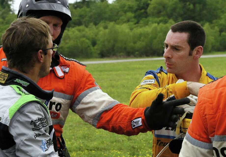 Two French drivers - Sebastien Bourdais, left, and Simon Pagenaud - have to be separated after a crash in the Grand Prix of Louisiana. Photo: Jonathan Bachman, FRE / FR170615 AP