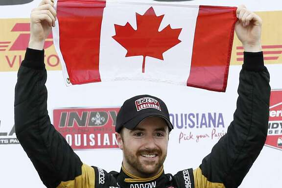 James Hinchcliffe, of Canada, celebrates after winning the IndyCar Grand Prix of Louisiana auto race, Sunday, April 12, 2015, in Avondale, La. (AP Photo/Jonathan Bachman)