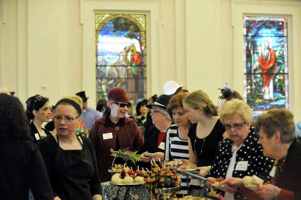 Attendees mingle at the 2nd Annual Victorian Tea in Troy event at Russell Sage College on Sunday, April 12, 2015, in Troy, N.Y. The event is a fundraiser for the YWCA of the Greater Capital Region. The event is the second largest fundraiser for the YWCA GCR, behind the Resourceful Women's Luncheon which the YWCA GCR will hold on September 30th. The YWCA GCR, started in 1883, gives support to homeless single women and homeless families. Daquetta Jones, the executive director of the YWCA GCR said