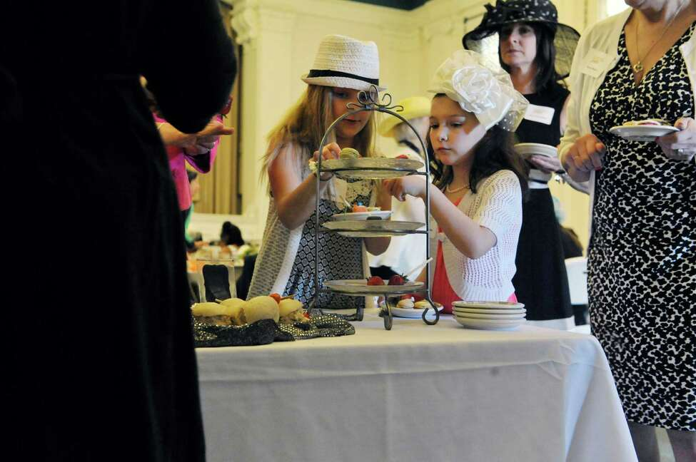 Best friends, Olivia Cardinale, left, 9, from Clifton Park and Sydney Kurzejeski, 9, from Troy, pick out some food at the 2nd Annual Victorian Tea in Troy event at Russell Sage College on Sunday, April 12, 2015, in Troy, N.Y. The event is a fundraiser for the YWCA of the Greater Capital Region. The event is the second largest fundraiser for the YWCA GCR, behind the Resourceful Women's Luncheon which the YWCA GCR will hold on September 30th. The YWCA GCR, started in 1883, gives support to homeless single women and homeless families. Daquetta Jones, the executive director of the YWCA GCR said
