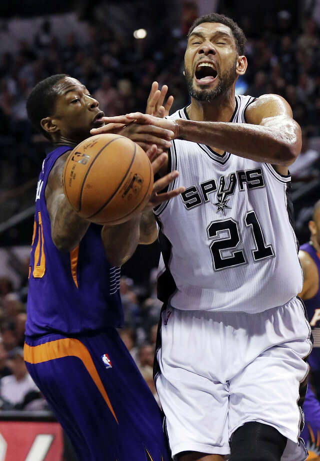 San Antonio Spurs' Tim Duncan loses control of the ball against Phoenix Suns' Archie Goodwin during second half action Sunday April 12, 2015 at the AT&T Center. The Spurs won 107-91. Photo: Edward A. Ornelas, Staff / San Antonio Express-News / © 2015 San Antonio Express-News