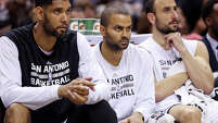 San Antonio Spurs' Tim Duncan (from left), Tony Parker, and Manu Ginobili watch first half action against the Phoenix Suns from the bench on April 12, 2015 at the AT&T Center.
