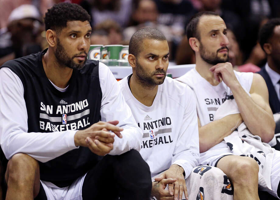 San Antonio Spurs' Tim Duncan (from left), Tony Parker, and Manu Ginobili watch first half action against the Phoenix Suns from the bench Sunday April 12, 2015 at the AT&T Center. Photo: Edward A. Ornelas, Staff / San Antonio Express-News / © 2015 San Antonio Express-News