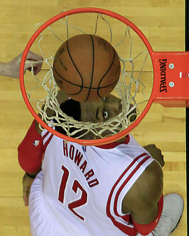 Houston Rockets center Dwight Howard  watches his shot fall into the basket during the second half quarter of NBA game action against the New Orleans Pelicans at the Toyota Center Sunday, April 12, 2015, in Houston. ( James Nielsen / Houston Chronicle ) Photo: James Nielsen, Staff / © 2015  Houston Chronicle