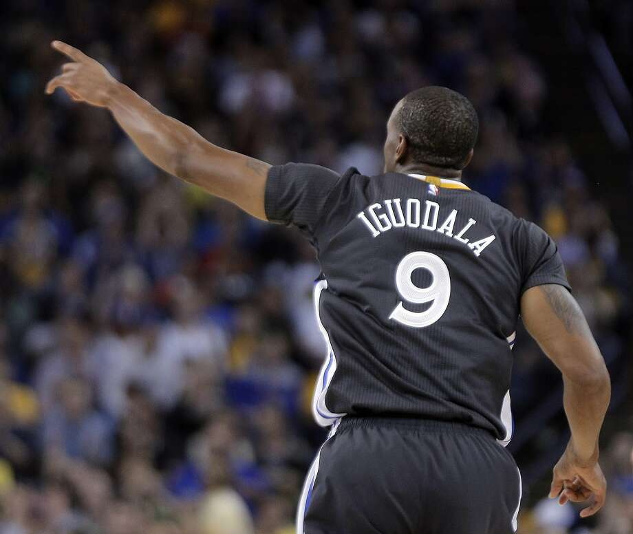 Andre Iguodala (9) gestures after making a shot during the Golden State Warriors game against the Minnesota Timberwolves at Oracle Arena in Oakland, Calif., on  Saturday, April 11, 2015. Photo: Carlos Avila Gonzalez, The Chronicle