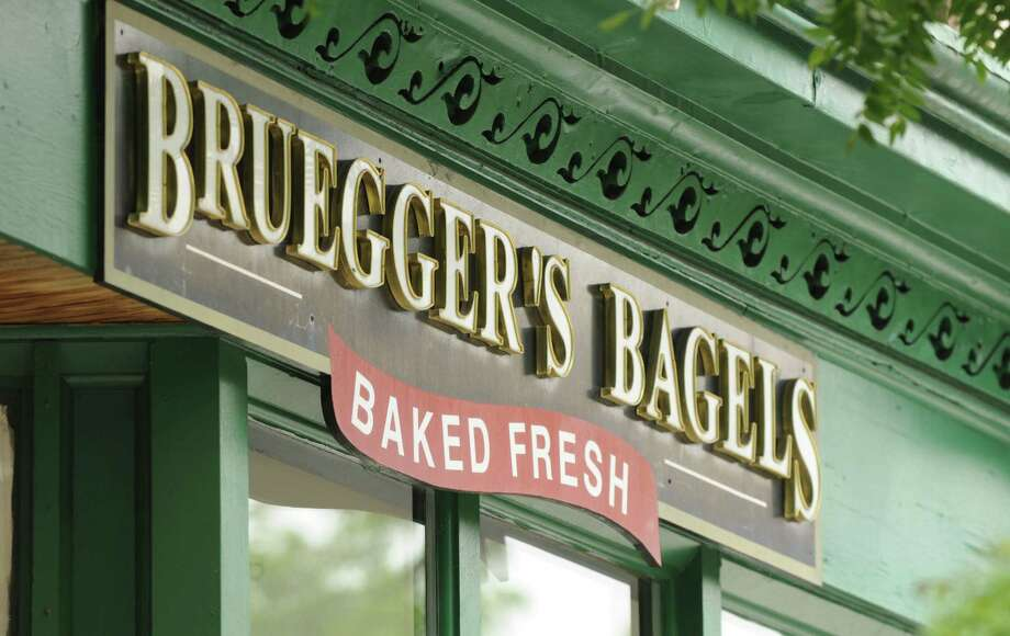 Bruegger's Bagelsis offering green bagels on March 16 and 17 and customers can redeem $2 off a bagel bundle (13 bagels) by using a coupon found on the company's website. Photo: Will Waldron / 00022943A