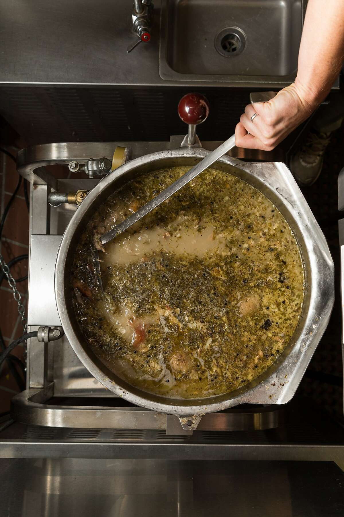 A pot of Kitchen Witch bone broth cooks for about 24 hours before being strained and bottled in Watsonville, Calif., Friday, April 3, 2015.