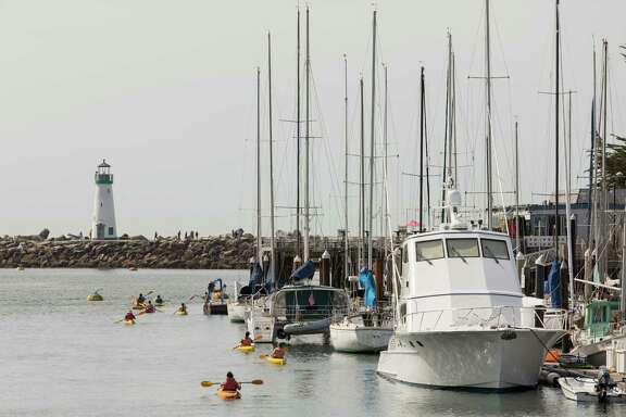 Kayakers in Santa Cruz Harbor in Santa Cruz, Calif., Thursday, April 9, 2015.