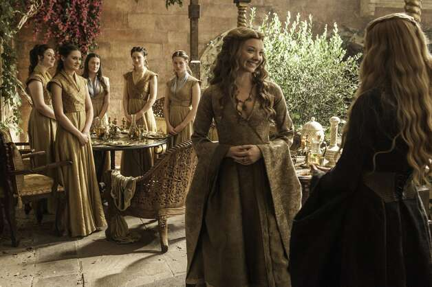 """Natalie Dormer, center, is often tasked with wearing some of the most elaborate costumes on """"Game of Thrones"""" as Queen Margaery. But what do she and other characters look like when they're not on-set? Click through to find out."""