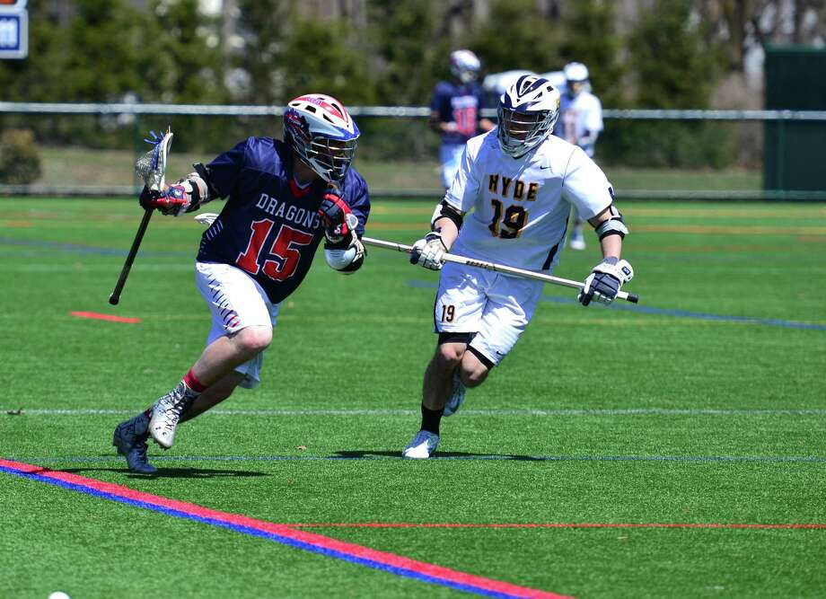 GFA junior Jack Mackle, left, had four goals and one assist in the varsity lacrosse team's victory over the Hyde School on Saturday, April 11. Photo: Contributed Photo / Westport News Contributed