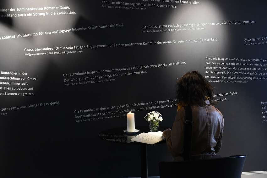 A woman signs a book of condolences for Germany's Nobel-winning author Guenter Grass at the Guenter Grass House in Luebeck, northern Germany, on April 13, 2015. Grass, who acted as a moral compass for many in the postwar nation but later provoked criticism over his own World War II past, died on April 13, 2015, aged 87, his publishers said. AFP PHOTO / TOBIAS SCHWARZTOBIAS SCHWARZ/AFP/Getty Images